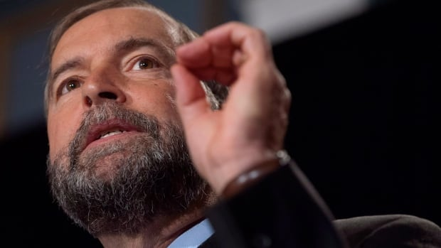NDP leader Tom Mulcair addresses party members at a national caucus strategy session on Sept. 11, 2013 in Saskatoon.