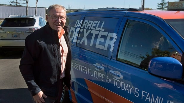 New Democrat Leader Darrell Dexter arrives to addresses supporters as he campaigns in Halifax on Monday.