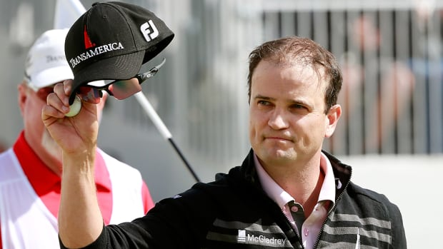 Zach Johnson waves to the crowd after putting on the 11th green during the final round of the BMW Championship at Conway Farms Golf Club in Lake Forest, Illinois, on Monday. Johnson prevailed after carding a six-under-par 65.