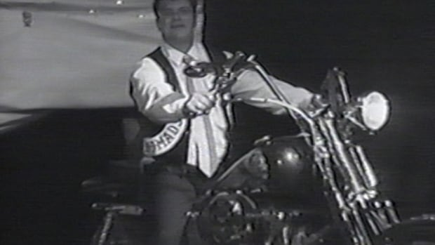 A still from René Charlebois' wedding video, showing Charlebois wearing a leather vest with Hells Angels patches.