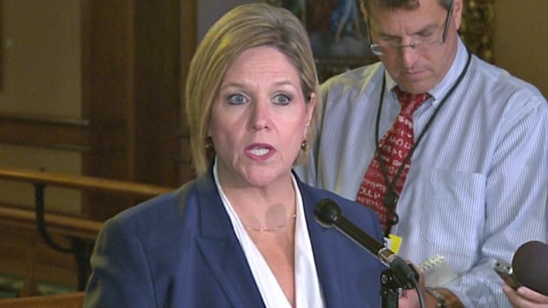 Ontario NDP Leader Andrea Horwath, seen speaking with reporters at the legislature on Sept. 16, 2013, says she wants to see the governing Liberals deliver on promises they made in order to get their budget passed earlier this year.