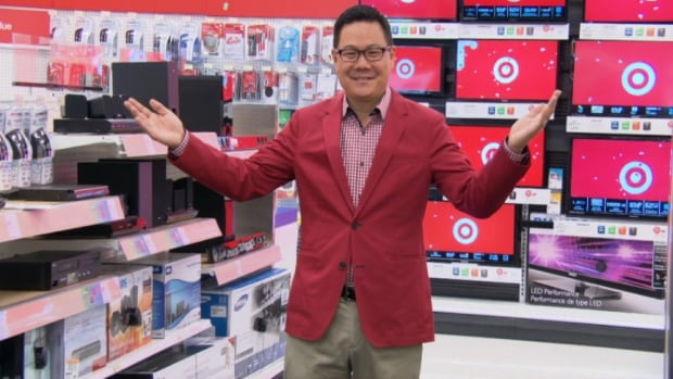 John Marioka shows off the new Target store at the Billings Bridge  Shopping Centre in Ottawa Monday, Sept. 16, 2013. The store opened to the public the following day.