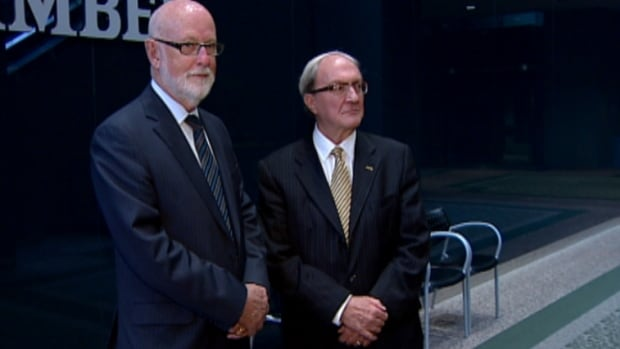 Long-serving Calgary aldermen Gord Lowe, left, and Dale Hodges attended their last council meeting on Monday. Both men have decided not to run again in October's civic election.