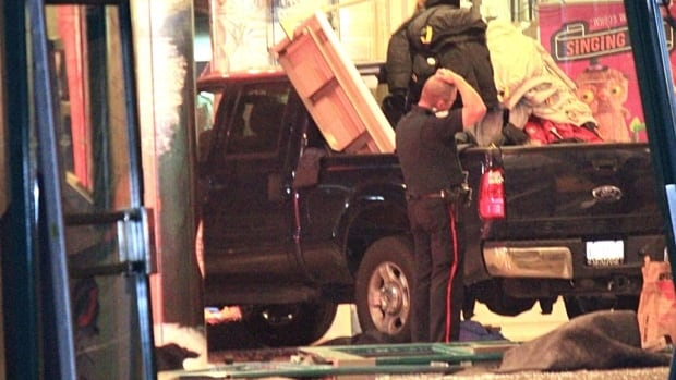 A pickup truck smashed through the front doors of a Sporting Life store at Sherway Gardens Mall early Tuesday. Police found the truck, but no sign of the driver in what appears to be a failed smash-and-grab theft.