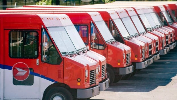 Canada Post vehicles sit outside a sorting depot. The post office says it has unused trucks and depots it will put towards establishing same-day delivery for online shoppers.