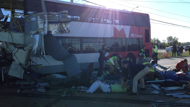 People are helped following a collision between an OC Transpo bus and Via Rail train in Barrhaven, a suburb of Ottawa.  The OC Transpo bus was travelling north on the Transitway, and Train 51 en route to Toronto was heading west when the collision occurred.