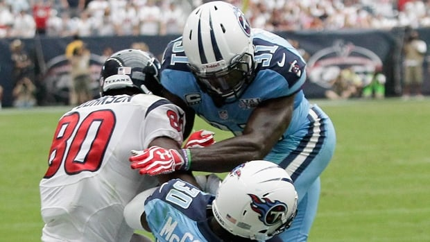 Titans safety Bernard Pollard (31) hits high on Andre Johnson in a 30-24 loss to the Texans at Reliant Stadium last Sunday.