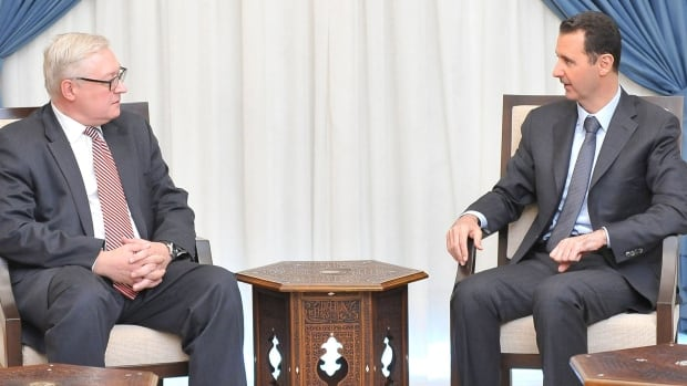 Syria President Bashar al-Assad, right, meets Russian Deputy Foreign Minister Sergei Ryabkov in Damascus Wednesday. The Russians have stepped up criticism of a UN report detailing the use of chemical weapons against Syrians.