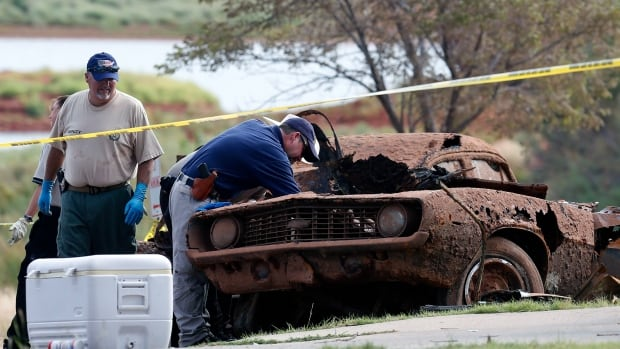 Oklahoma Highway Patrol divers stumbled upon two mud and rust-covered vehicles on the bottom of Foss Lake during tests of new sonar equipment. On Tuesday, six skeletons were recovered.