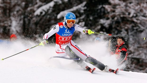 Martina Schild of Austria is retiring from competitive skiing before the 2014 Sochi Winter Games because of chronic back pain.