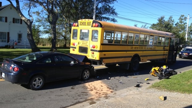 A crash between a motorcycle, a school bus and a third vehicle in Glace Bay, Cape Breton sent a man to hospital.