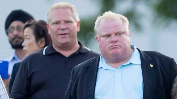 Toronto Mayor Rob Ford (right), seen here at a Conservative Party BBQ in August 2013 with his brother Coun. Doug Ford, is hosting his 'Ford Fest' public community barbecue in Scarborough this Friday.