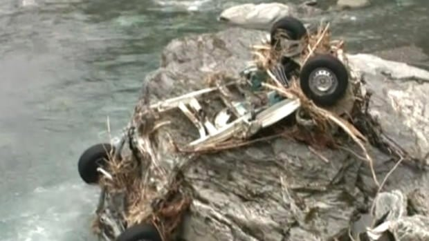 The chassis of the missing couple's wrecked rental van was found on Tuesday in the Haast River gorge.
