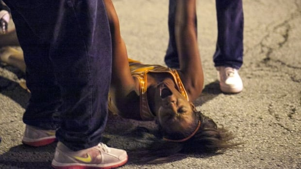 A woman becomes emotional near the scene of a Sept. 19 shooting at Cornell Square Park in Chicago's Back of the Yard neighbourhood that left multiple people wounded, including a 3-year-old boy.
