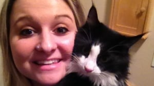 Jennifer McLaren was hurt when she tried stopping a pit bull's attack on her cat