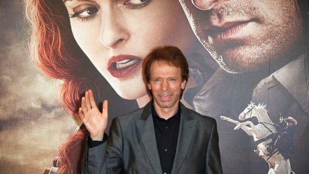 Producer Jerry Bruckheimer poses for photographers as he arrives at cinema for the French premiere of Lone Ranger in Paris, on July 24.