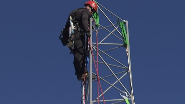 A high angle worker takes a mandatory course at a new training tower in Paradise.