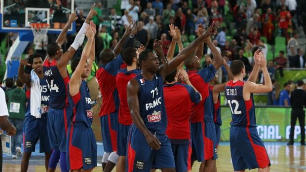 France players wave to their fans after beating Spain in the EuroBasket semifinal at the Stozice Arena, in Ljubljana, Slovenia on Friday.