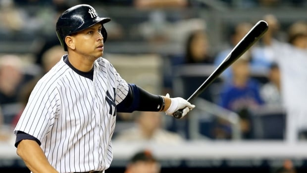Alex Rodriguez watches his 24th grand slam in the seventh inning against the San Francisco Giants on September 20, 2013 at Yankee Stadium in New York City.