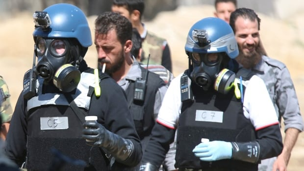 UN chemical weapons experts, shown here in gas masks, were able to confirm that a sarin gas attack was launched in August near Damascus. A U.S.-Russia deal gave the Syrian regime a Saturday deadline to submit a list of its chemical weapons stockpiles and facilities so they can be destroyed.