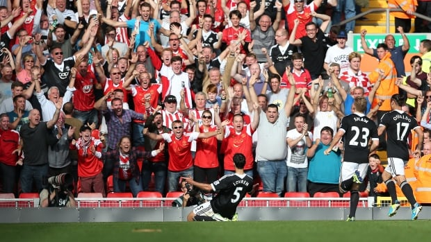 Dejan Lovren of Southampton celebrates his winning goal to the crowd during the Barclays Premier League match between Liverpool and Southampton at Anfield on Saturday in Liverpool, England.