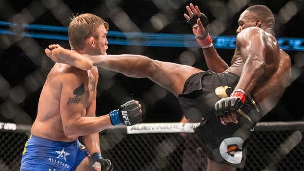 Jon Jones, right, lands a kick on Alexander Gustafsson during the bout in Toronto on Saturday September 21, 2013.