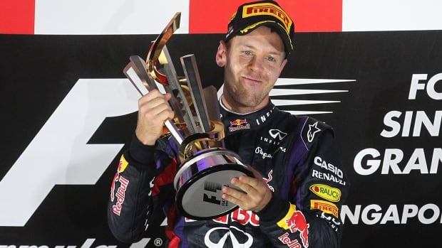 Red Bull driver Sebastian Vettel beat Fernando Alonso by a massive 32.6 seconds to win the Singapore Formula One Grand Prix on the Marina Bay City Circuit in Singapore, Sunday.