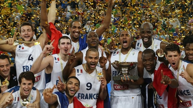 French team celebrates with the trophy after the EuroBasket final against Lithuania at the Stozice Arena, in  Slovenia, Sunday, Sept. 22, 2013.