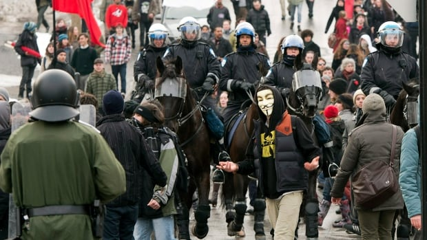 Police move in to clear out students in a protest against tuition fee hikes Tuesday, February 26, 2013 in Montreal.