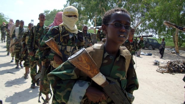A young boy leads al-Shabaab fighters as they conduct a military exercise in northern Mogadishu's Suqaholaha neighbourhood, Somalia. Al-Shabaab has claimed responsibility for the gun and grenade attack on a shopping mall in Nairobi, Kenya.