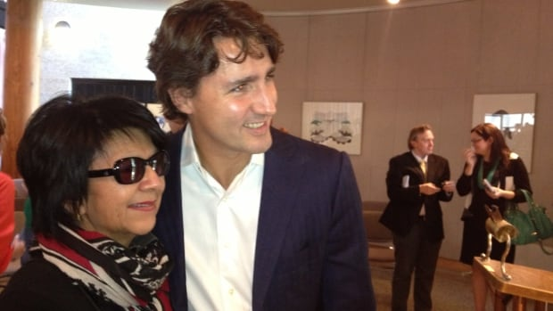 Justin Trudeau poses with a supporter at Brandon University on Tuesday.