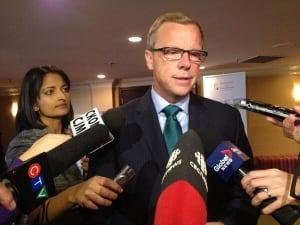 Brad Wall speaks to reporters in Saskatoon September 24, 2013