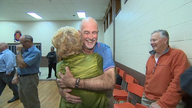Ken McDonald hugs a supporter after winning the mayoral chair in Conception Bay South, ousting Woodrow French.