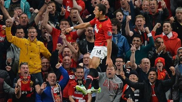 Manchester United's Javier Hernandez celebrates after scoring against Liverpool.