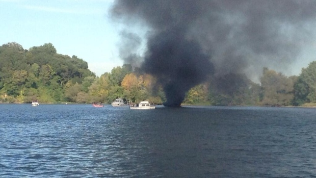 A boat has caught fire in Hamilton Harbour. Black smokes can be seen