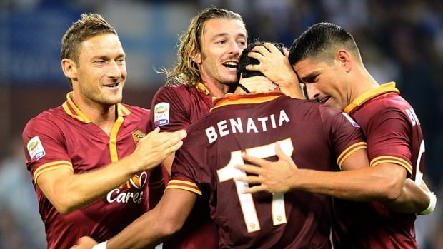 Roma players celebrate during the match against Sampdoria on September 25, 2013, in Luigi Ferraris stadium in Genoa.