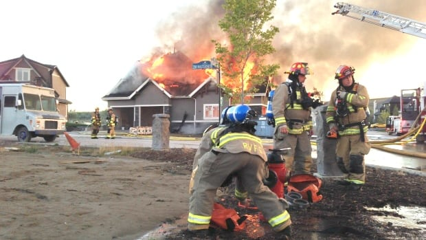 Crews battled a large house fire on the northwestern edge of Calgary last Friday morning.
