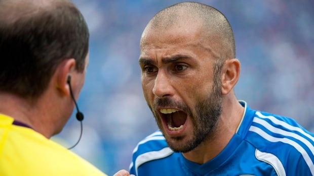 Montreal Impact's Marco Di Vaio, right, argues with an official during the second half of a 3-0 loss to the Vancouver Whitecaps on Saturday.