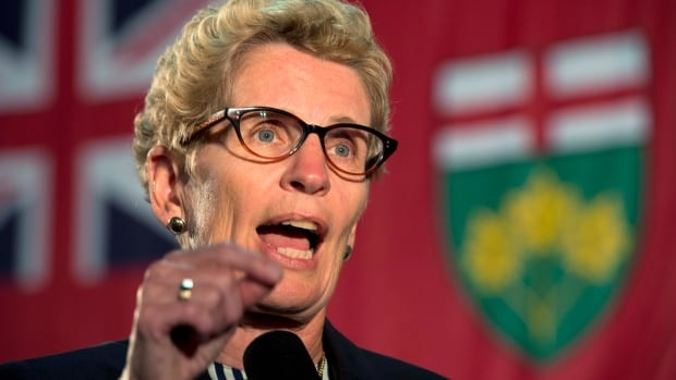 Ontario Premier Kathleen Wynne has served Tory leader Tim Hudak and MPP Lisa MacLeod.