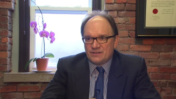 The Liberal justice critic is questioning whether or not the government's recent hiring of outspoken lawyer Peter Ralph was politically motivated.