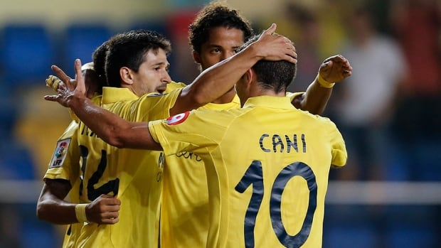 Villarreal players celebrate after a goal against Espanyol at the El Madrigal stadium in Villareal on September 26, 2013.