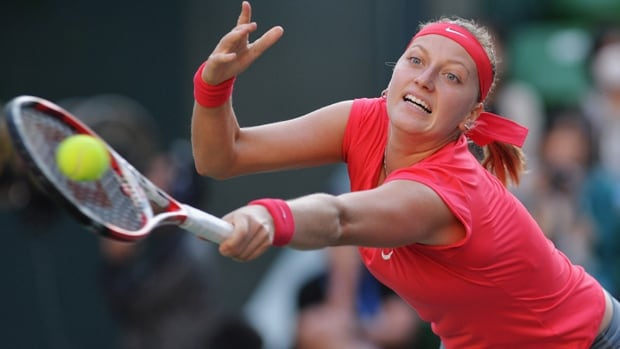 Seventh-seeded Petra Kvitova lunges to make a return in Friday's 3-6, 6-3, 7-6 win at Tokyo.
