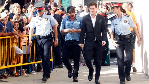 FC Barcelona striker Lionel Messi, second from right, arrives at court in Gava, Spain, to address tax fraud charges on Friday.