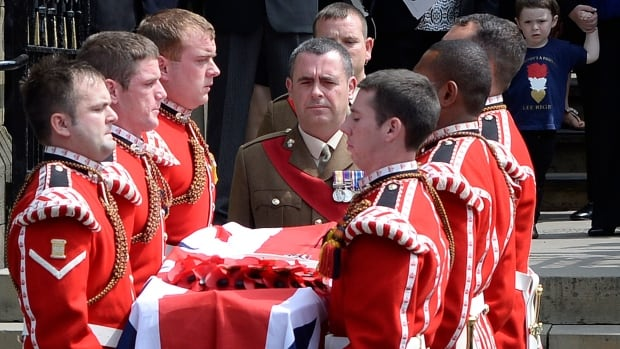 More than 1,000 well-wishers gathered in July at a military funeral on Friday for the British soldier who was hacked to death in broad daylight on a street in Woolwich, southeast London.