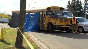 Tarps cover St. Albert school bus that hit and killed child