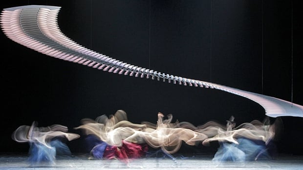 A long exposure photo shows members of the Vienna State Opera Ballet performing on stage at the Stage opera house in Vienna in February 2013.