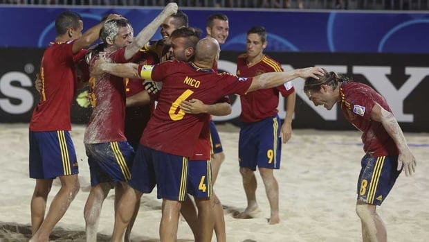 Team Spain celebrates after its victory in the 2013 FIFA semifinal World Cup beach soccer match against Brazil, on Saturday in Papeete on the French Polynesian island of Tahiti.