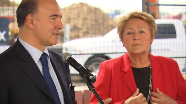French finance minister, Pierre Moscovici, attended an event for French aviation firm Aerolia in Mirabel, Que. yesterday, along side Quebec Premier Pauline Marois.