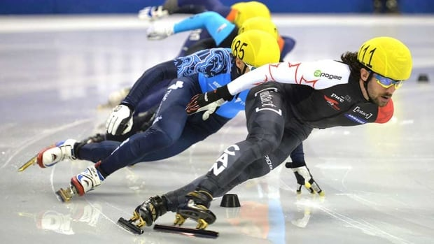 Charles Hamelin of Canada, right, won the men's 500-metre speed skating event at the ISU Short Track World Cup in Shanghai on Saturday.