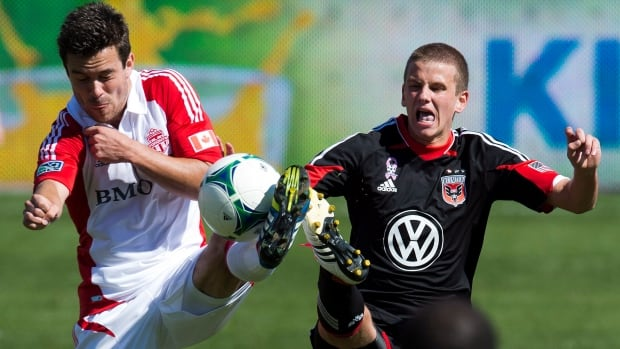 Toronto FC forward Andrew Wiedeman, left, and D.C. United midfielder Colin Martin are shown here during a match between the two clubs last June.